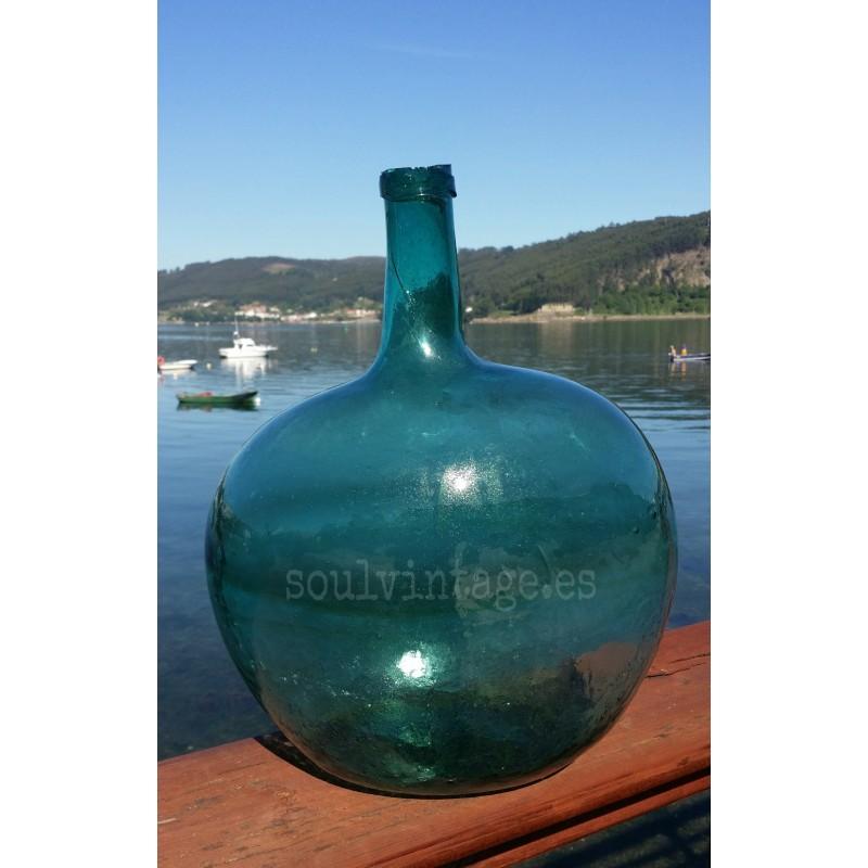 Antigua damajuana de vidrio soplado